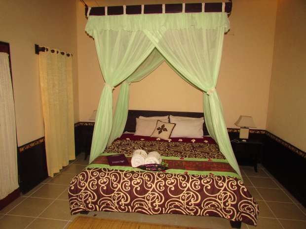 Man's cottage bedroom, Pemuteran